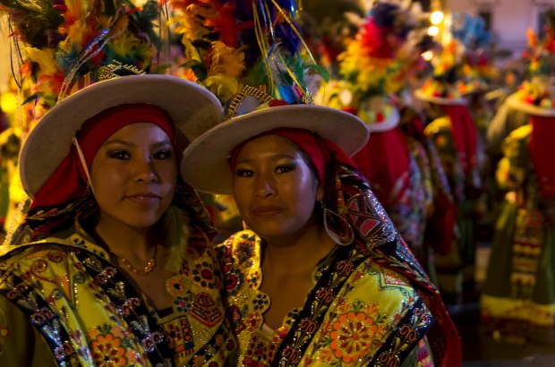 the parade lasted all day and deep into the night with everyone dressed up in traditional costumes from all around Bolivia