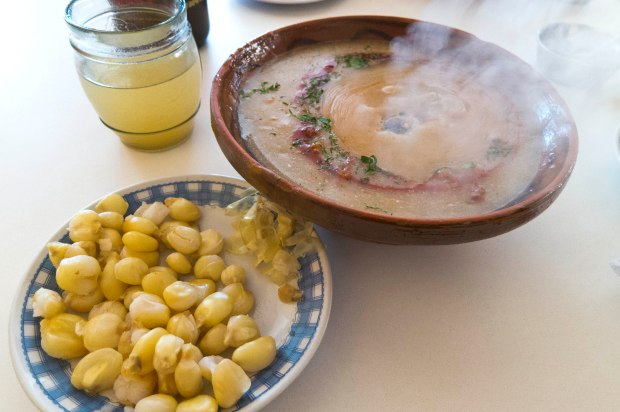 the soup is always served with mote (hominy).  It's eaten in replace of a bread alongside many dishes in Bolivia