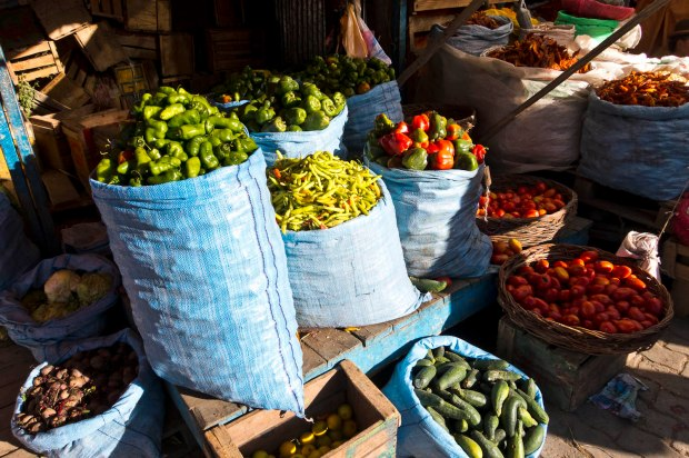 the market in El Alto selling peppers in every color