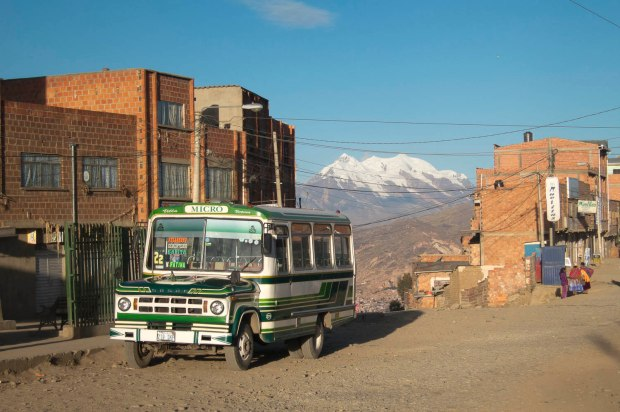 typical La Paz transportation with Illimani in the background