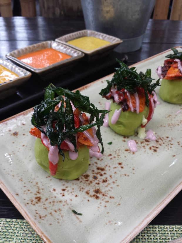 modern interpretation of the causa topped with grilled octopus