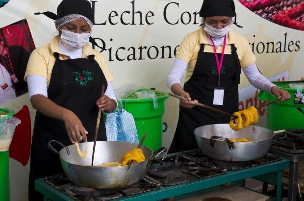 frying up fresh picarones